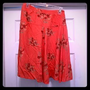 Peach/pink skirt above knee with flowers